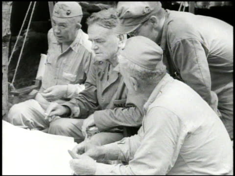 s navy fleet admiral william 'bull' halsey jr sitting at camp meeting w/ general roy geiger amp officers wwii world war ii pacific front - william halsey stock-videos und b-roll-filmmaterial