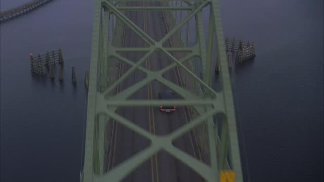 a navy ford explorer drives across the yaquina bay bridge in newport, oregon. - newport oregon stock videos & royalty-free footage