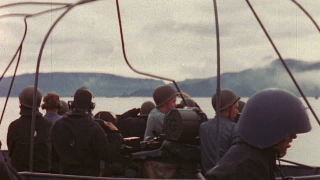 navy gun and bridge crew members keeping stations during the aleutian islands campaign during world war ii / kiska alaska united states  - aleutian islands stock videos and b-roll footage