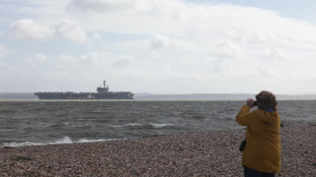 navy nimitz-class aircraft carrier uss george h.w. bush is pictured anchored off the coast on july 27, 2017 in portsmouth, england. - anchored stock videos & royalty-free footage