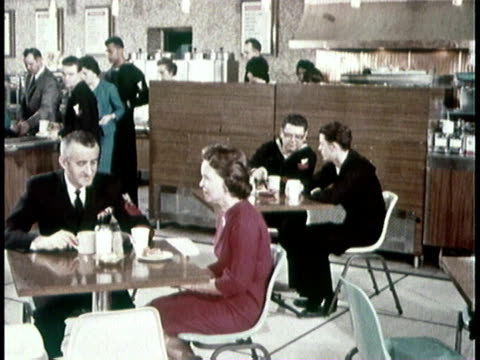 1966 montage navy personnel eating in a cafeteria / united states - femmina con gruppo di maschi video stock e b–roll