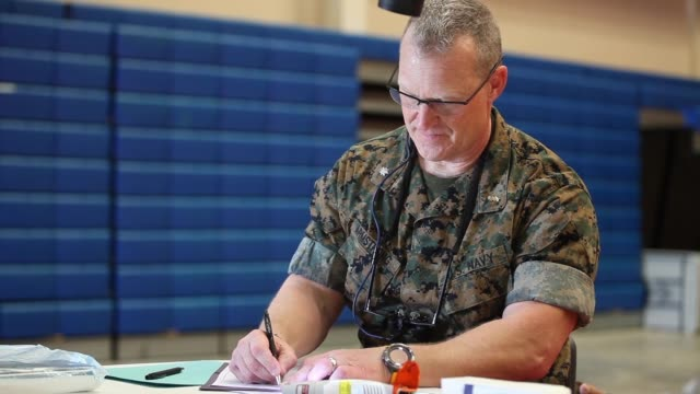 us navy personnel provide free dentistry care to civilians as part of the innovative readiness training program at the mayaguez care site puerto rico... - medical resident stock videos and b-roll footage