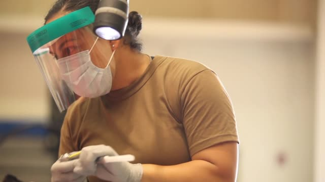 US Navy personnel provide free dentistry care to civilians as part of the Innovative Readiness Training program at the Mayaguez care site Puerto Rico...