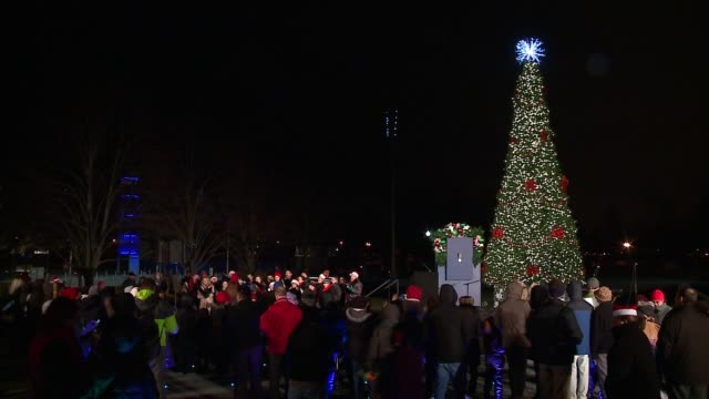 wgn navy pier lit its first annual christmas tree in polk bros park wednesday evening with a little help from santa on nov 30 2016 - christmas tree lighting ceremony stock videos & royalty-free footage