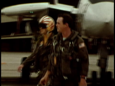 1979 montage us navy pilots walk away from fighter jet as ground crew services the aircraft / san diego, california, united states - pilot stock videos & royalty-free footage