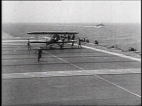 1930 montage navy planes landing on deck of uss lexington / hampton roads, virginia, usa - 1930 stock-videos und b-roll-filmmaterial