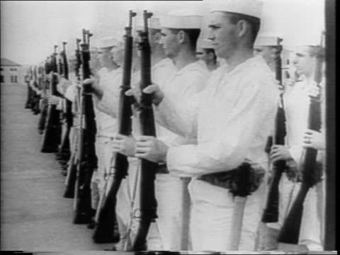 navy recruiting center poster / young recruits walking singlefile into center / recruits examined given supplies / blackboard instruction sailors... - military recruit stock videos and b-roll footage
