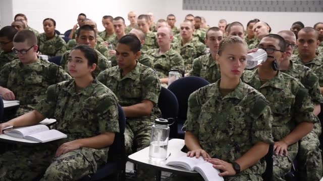 navy recruits perform group physical training and learn basic first aid at recruit training command . the hands-on learning curriculum at rtc tests... - military recruit stock videos & royalty-free footage