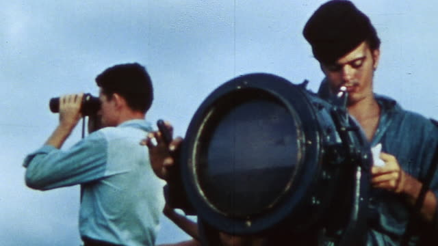 navy sailor flashing morse code using signal lights and sailor looking out into the distance with binoculars during wwii / peleliu, palau - sending stock videos & royalty-free footage