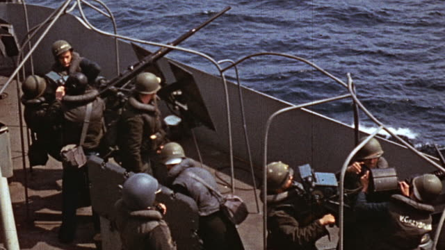 navy sailors aboard ship loading cannisters and firing anti-aircraft guns during world war ii - anti aircraft stock videos & royalty-free footage