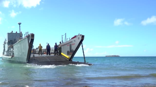 us navy sailors assigned fleet activities sasebo japan offload and load vehicles and equipment from landing craft units lcu's on november 12 2018 in... - fleet of vehicles stock videos and b-roll footage