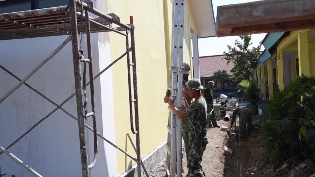 us navy sailors assigned to naval mobile construction battalion and members of the indonesian national armed forces engineering battalion carry out... - step ladder stock videos & royalty-free footage