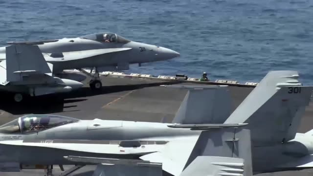 navy sailors direct aircraft during flight deck operations aboard the aircraft carrier uss george h.w. bush . bush is operating in the arabian gulf... - ペルシャ湾点の映像素材/bロール