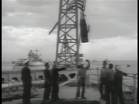 navy sailors on deck lowering artillery shell hoist us marines boarding ship us naval officers standing at attention sot roll call of names - 米国海軍点の映像素材/bロール