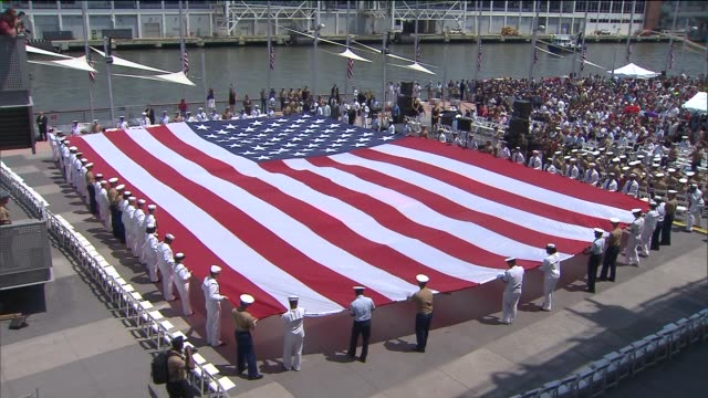 navy seals roll out american flag on november 11, 2011 in new york, new york - us navy stock videos & royalty-free footage