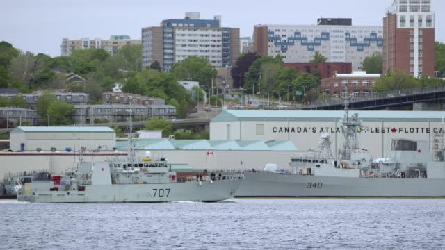 stockvideo's en b-roll-footage met navy ship arrives at harbor - amerikaanse zeemacht