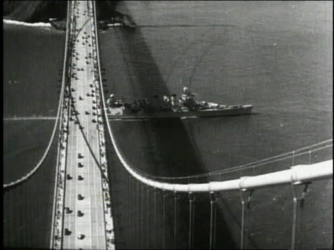 1940 WS Navy ship passing under Golden Gate Bridge / San Francisco, California, United States