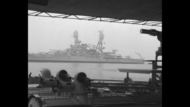 Navy ships in harbor / POV through porthole of a battleship in harbor / POV from one ship of another close by / US military planes fly in formation /...