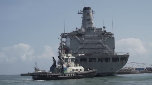 us navy tactical patrol boats with command task group camp lemonnier provide security to military sealift command fleet replenishment oiler usns... - henry j. kaiser stock videos and b-roll footage