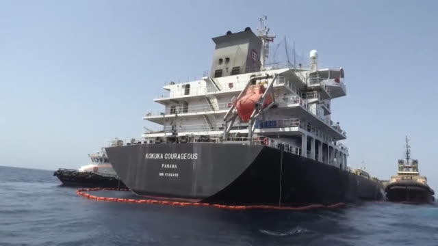stockvideo's en b-roll-footage met navy take journalists to see oil tanker attacked my mine, the kokuka courageous, in straits of hormuz uae, iran are suspected of carrying out the... - perzische golf