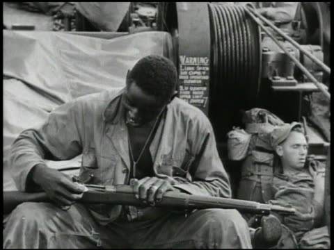 s navy transport ships at sea us 163rd infantry regiment soldiers on deck cleaning rifles eating writing letter talking night vs soldiers on watch on... - gewehr stock-videos und b-roll-filmmaterial