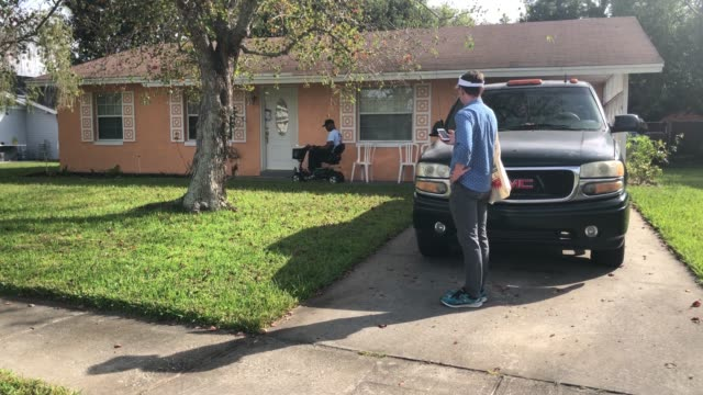 us navy veteran rick rogers canvases residents is support of andrew gillum on november 1 2018 in kissimmee florida the veteran is knocking doors to... - social security stock videos & royalty-free footage