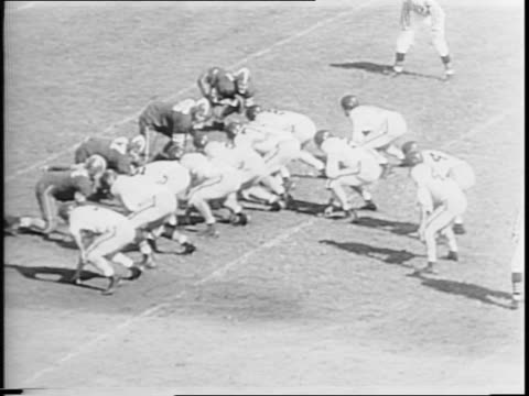 navy vs duke at baltimore stadium / midshipmen marching on to field / game highlights including navy touchdown moves by harold a hamburg of navy /... - anno 1944 video stock e b–roll