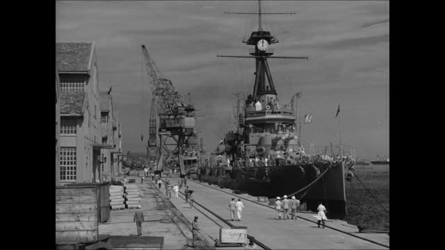 stockvideo's en b-roll-footage met navy yard entrance ls brazilian navy cruisers at dock ms destroyer ship in dry dock ms ship launching crowds fg wwii - 1942