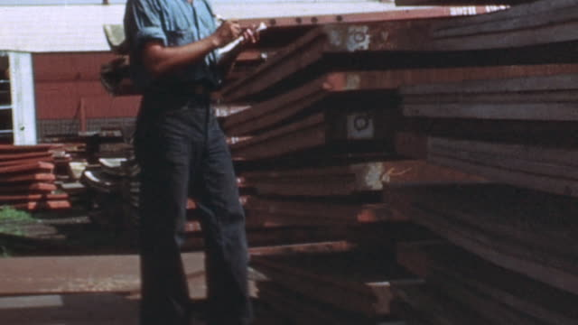 navy yard inventory clerk checking steel plates stacked in storage area / newport news, virginia, united states - file clerk stock videos & royalty-free footage