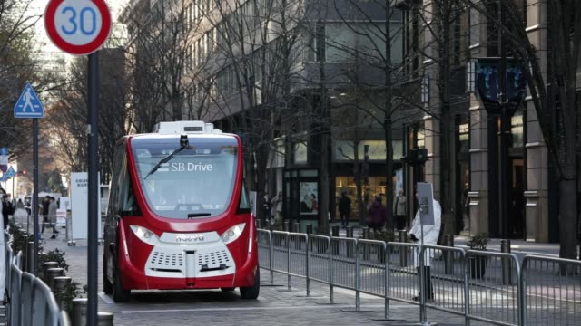 A Navya Arma autonomous shuttle bus manufactured by Navya Technologies SAS travels during a test drive conducted by SB Drive Corp a unit of SoftBank...