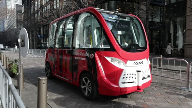 A Navya Arma autonomous shuttle bus manufactured by Navya Technologies SAS stands on display during a test drive conducted by SB Drive Corp a unit of...