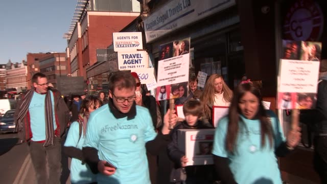 protest march in north london england london ext protesters along with banner 'free nazanin' demonstrators marching with placards richard ratcliffe... - nazanin zaghari ratcliffe video stock e b–roll