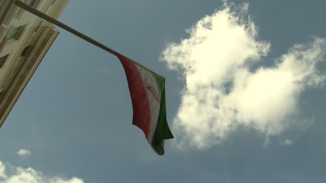 nazanin zaghariratcliffe jailed in iran for five years on secret charges t01091614 / 192016 london ext various of iranian flag flying outside the... - nazanin zaghari ratcliffe video stock e b–roll