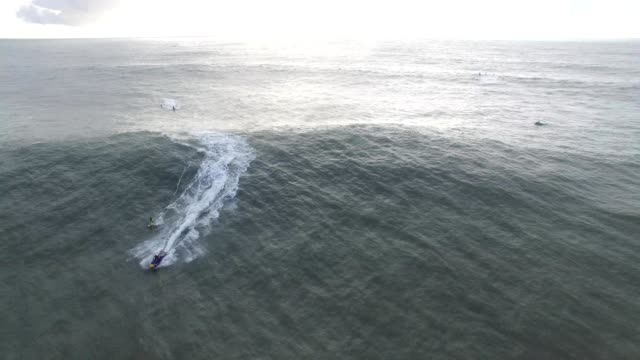 Nazare Surf on a Big day.  Surfer crashes, and board continues with out him.