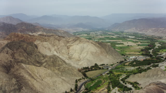 Nazca And Farm Valley In Arid Desert