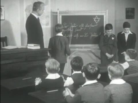 nazi antisemitic propaganda literature, children in school learning from antisemetic books. - nazism video stock e b–roll