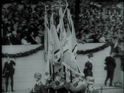 nazi color guard marching with nazi flags during parade passing reviewing stand in germany / nazi soldiers goose stepping on parade route with rifles... - stivale video stock e b–roll