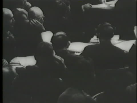 nazi defendants testify about the holocaust at the nuremberg trials and a montage shows jews with numbers tattooed on their arms. - nuremberg trials stock videos & royalty-free footage