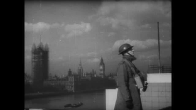 nazi fighter planes travel up the thames river as sirens sound, fighter planes shoot and bombs drop on the city on the first night of the london blitz - air raid stock-videos und b-roll-filmmaterial
