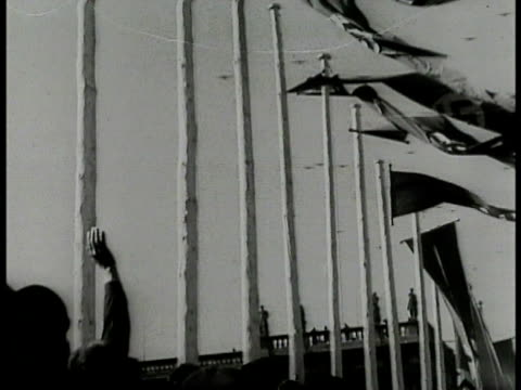 nazi flags on poles la nazi bomber airplanes flying overhead la ws nazi flags on poles german airplanes flying bg ws crowd of germans doing nazi... - nazi swastika stock videos and b-roll footage