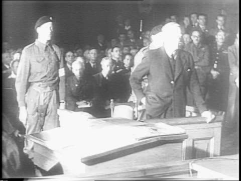 nazi fuehrer vidkun quisling enters oslo court for trial / correspondents / british armed guards / quisling in prisoner's dock wiping face with... - brigade stock videos and b-roll footage
