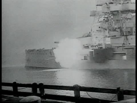 Nazi German battle ship Navy men on ship balcony watching cannons fire smoke Sailor looking through gun sight VS Naval assault on land Navy men...