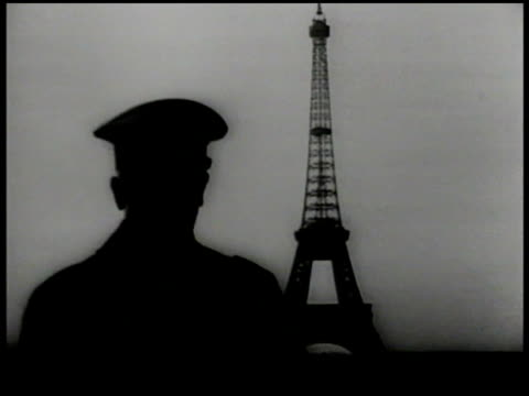stockvideo's en b-roll-footage met nazi german officials in car driving toward arc de triomphe, paris. adolf hitler w/ officers on balcony looking at eiffel tower. hitler looking... - nazism