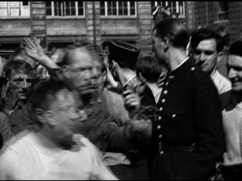 paris france nazi german pows guarded by gendarmes being moved through crowd male in glasses spitting on man passing civilians beating... - prigioniero di guerra video stock e b–roll