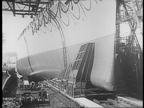 nazi german ship bismarck under construction / bismarck slips into the atlantic ocean / hitler and soldiers walk the decks of the shipyard / ship has... - 1941 bildbanksvideor och videomaterial från bakom kulisserna