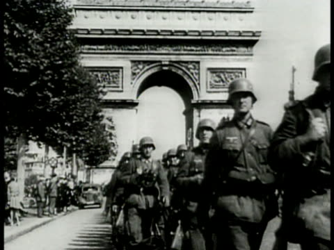 nazi german soldiers in formation walking down champs-elysees w/ arc de triomphe bg. german soldiers walking by. nazi soldiers walking by carrying... - nazi swastika stock videos & royalty-free footage