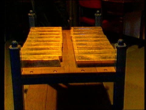 london bank of england seq gold ingots wheeled along on trolley and more stacked on shelves - ingot stock videos & royalty-free footage