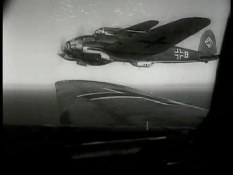 nazi heinkel he 111 bombers inflight pilot controlling plane giving directions aerial english channel convoy of battle ships wwii - battle stock videos & royalty-free footage