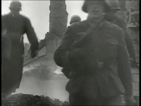nazi infantry soldiers walking through burned rubble of house children boys walking on bombed town sidewalk carrying bundles smoke bg refugees... - infantry stock videos & royalty-free footage