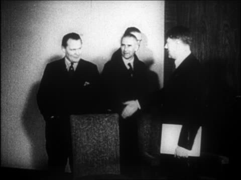 vídeos de stock, filmes e b-roll de nazi leaders entering room to join hitler / hitler just appointed as chancellor - 1933